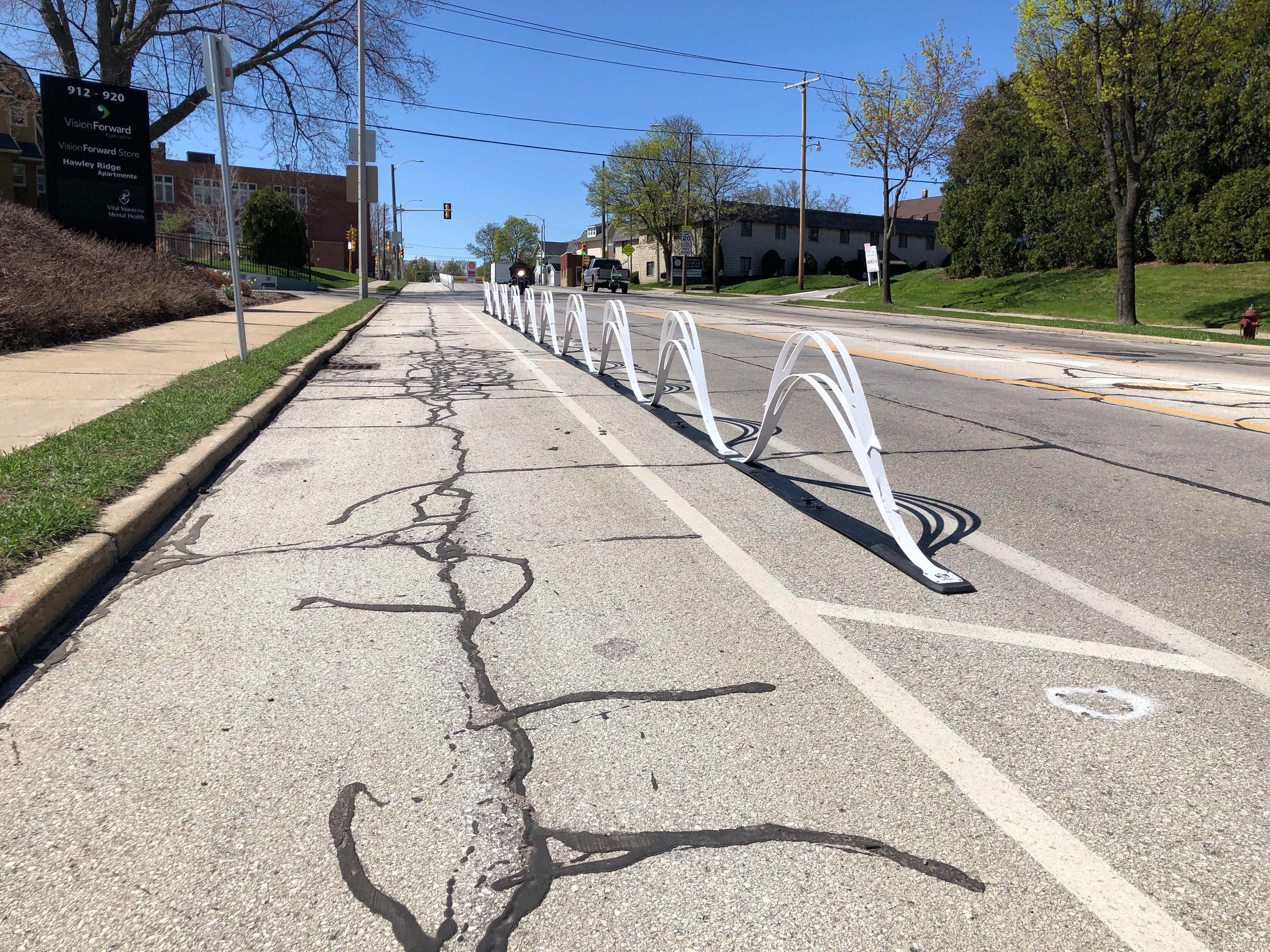 Wave delineators on the N. Hawley Rd. protected bike lane. Photo by Jeramey Jannene.