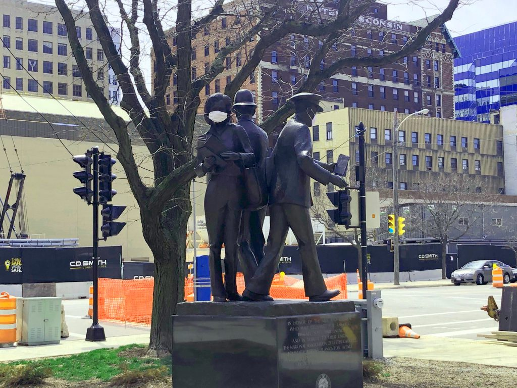 Letter carriers statue in Postman Square. Photo by Dave Reid.
