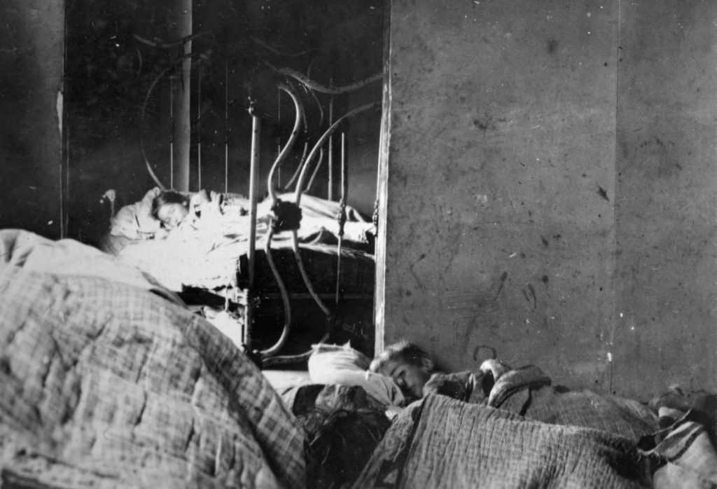 Two children in Lincoln County are bedridden during the global influenza pandemic that struck Wisconsin in 1918. Wisconsin Historical Society/Wisconsin Watch.