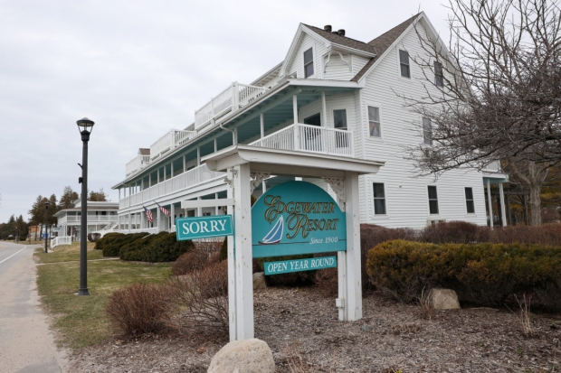 """The Edgewater Resort, usually open year-round, displays a """"Sorry"""" sign on March 31, 2020, in Ephraim, Wis. Hotels and other tourist attractions had closed during the pandemic to discourage tourists from visiting. Coburn Dukehart/Wisconsin Watch."""