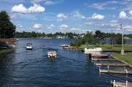 Boaters pass through the channel between Kawaguesaga Lake and Minocqua Lake in Oneida County. Photo by Ezra Zeitler/WisContext.