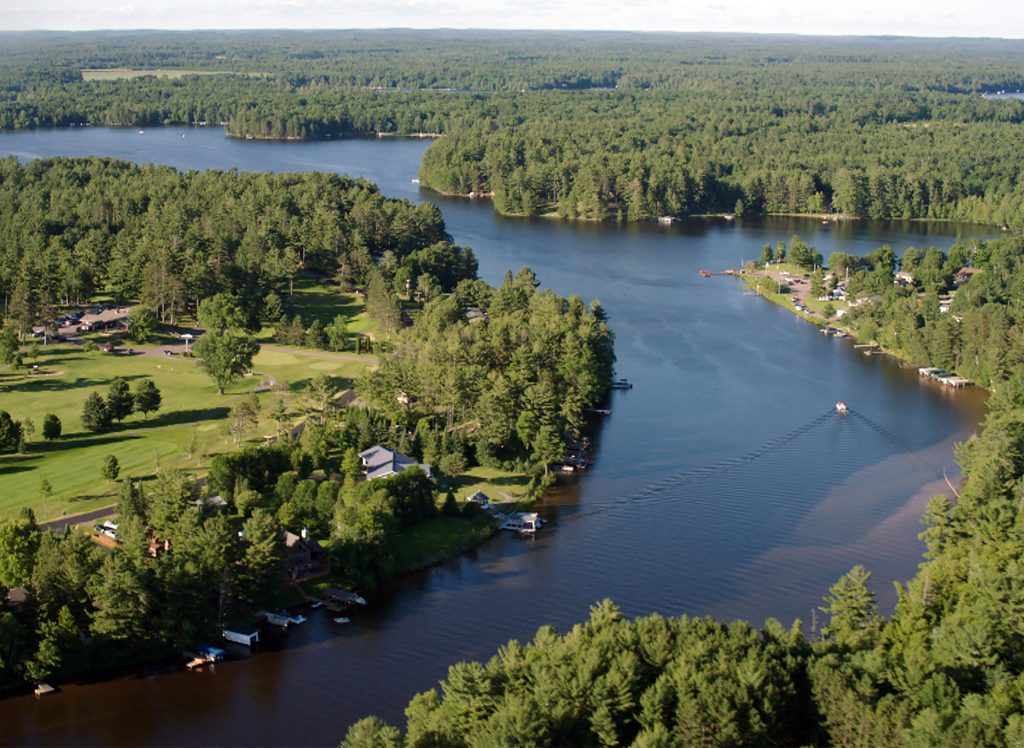 The city of Eagle River and the surrounding area have many waterfront properties that are occupied on a seasonal basis. An aerial view of the Eagle River Golf Course and Yellow Birch Lake is featured in the 2018 PBS Wisconsin program Wisconsin Water From the Air. Photo from PBS Wisconsin.