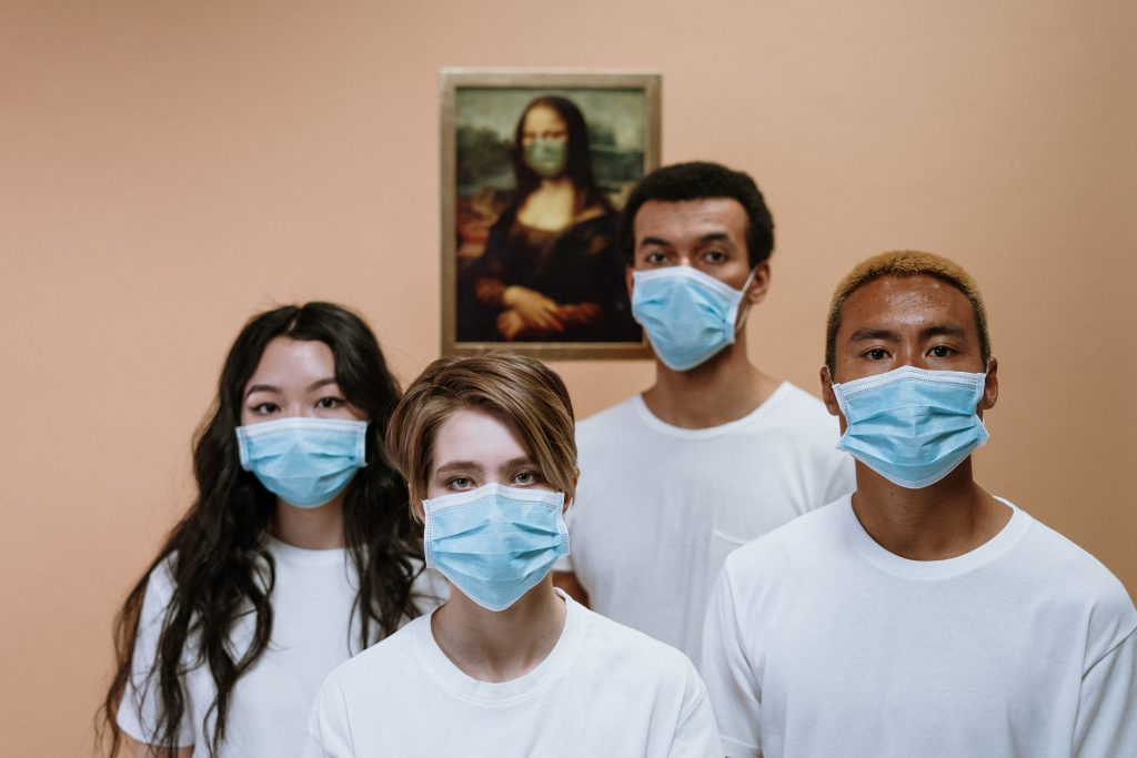 Workers wearing face masks. Photo by cottonbro from Pexels.