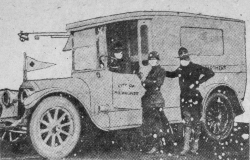 Women took over traditional male roles during the 1918 Spanish flu epidemic. In this photo published in the Milwaukee Journal on Oct. 22, 1918, crew member Edith Courteen of Milwaukee stands beside a city ambulance along with an unidentified state National Guardsman, all wearing mandatory gauze masks. Wisconsin Historical Society Library and Archives/Wisconsin Watch.