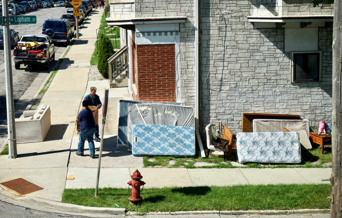Landlords in Wisconsin could again legally issue eviction notices starting on May 27 — the first step of the eviction filing process. Here, an eviction takes place in Milwaukee's Burnham Park neighborhood in 2017. Photo by Adam Carr / Milwaukee Neighborhood News Service.