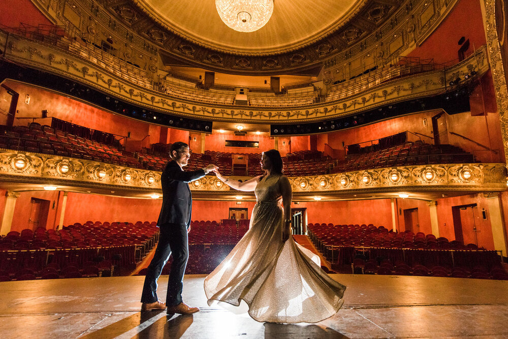 Bridge and groom onstage at the Pabst Theater. Image from PTG.