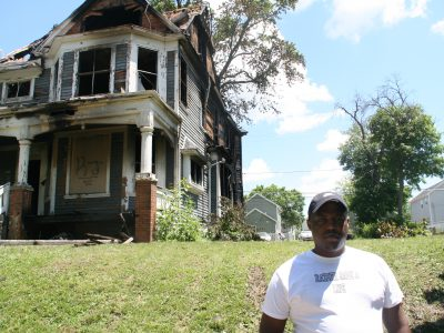 Activists Clean Up Around Burned House As Questions Remain