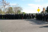 Milwaukee Police Department officers block a freeway on-ramp from protesters. Photo by Jeramey Jannene.
