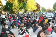 On May 30th, protesters sat in the street in front of Mayor Barrett's home listening to speeches. Photo by Jeramey Jannene.