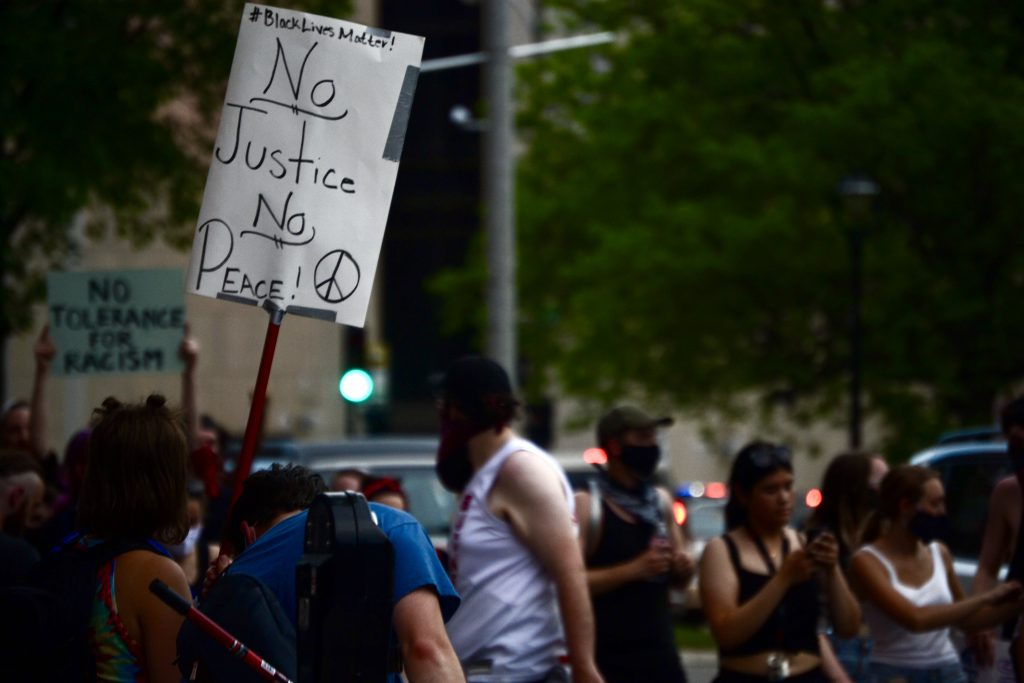 """""""No Justice, No Peace,"""" reads the sign. Photo by Maddy Day."""