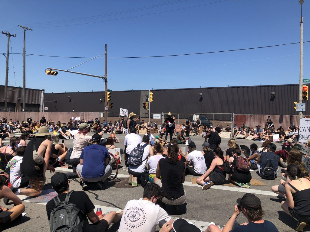 Group of protesters sitting at Mitchell Street. Photo by Jeramey Jannene.