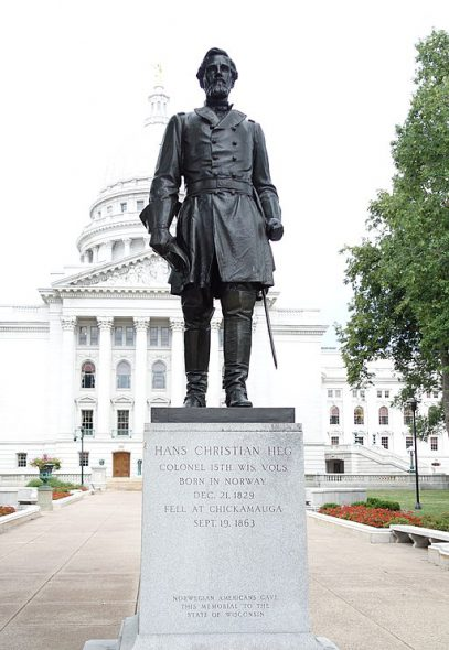 Hans Christian Heg memorial by Paul Fjelde (1892–1984), outside the Wisconsin State Capitol. Photo by Daderot. (CC0 1.0 universal public domain).