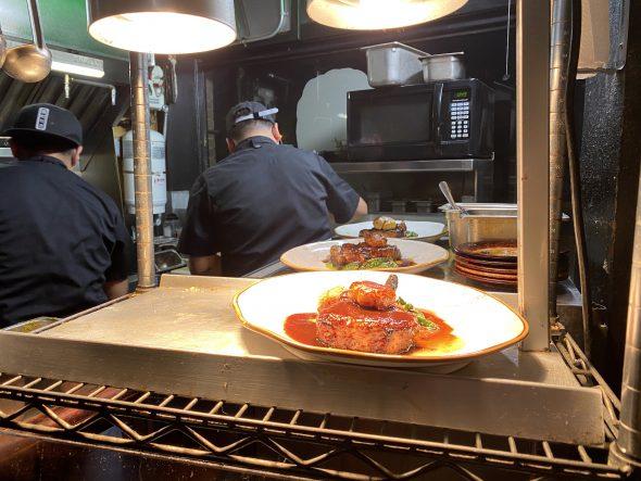 Two chefs at work at La Dama. Photo by Cari Taylor-Carlson.