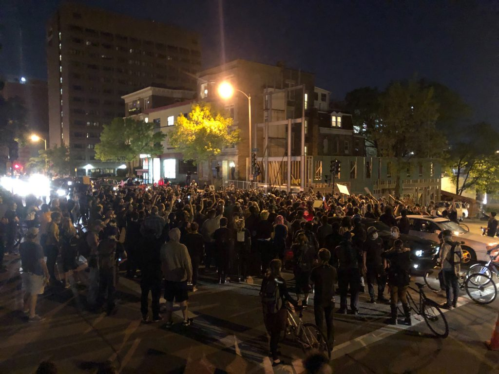A rally in the intersection of N. Milwaukee St. and E. Knapp St. during the protest march. Photo by Jeramey Jannene.