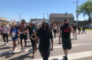 Frank Nitty leads a march north through Walker's Point. Photo by Jeramey Jannene.