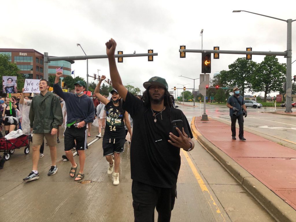 Frank Nitty leads a march on June 9th in Wauwatosa. Photo by Jeramey Jannene.