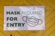 Mask requirement sign at Allie Boy's Bagels. Photo by Jeramey Jannene.