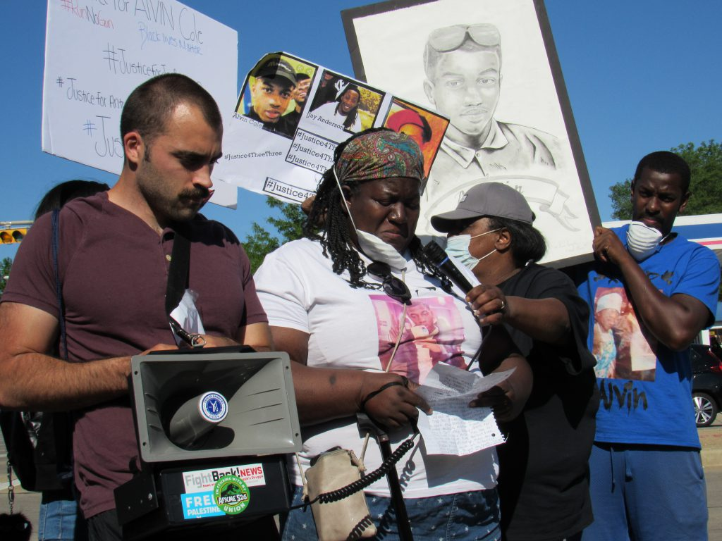 Tracy Cole, Alvin's mother, speaks to the marchers. Photo by Isiah Holmes/Wisconsin Examiner.