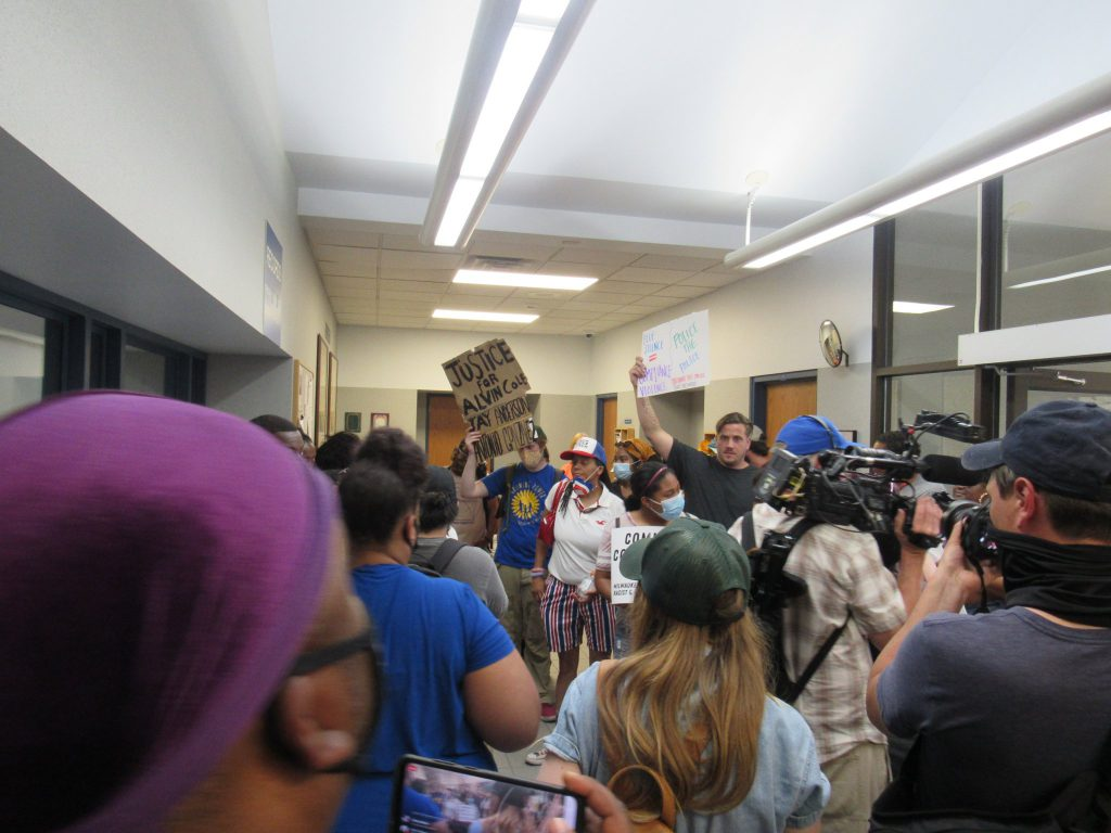 Protesters flow into the Wauawatosa Police Department's small lobby area. Photo by Isiah Holmes/Wisconsin Examiner.