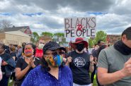 Demonstrators gather in Milwaukee Friday, May 29, 2020, to demand justice for George Floyd a Minneapolis man who was killed by police while in custody. Corrinne Hess/WPR.