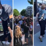 Thousands March While Attorney Arrested For Spitting In Protester's Face