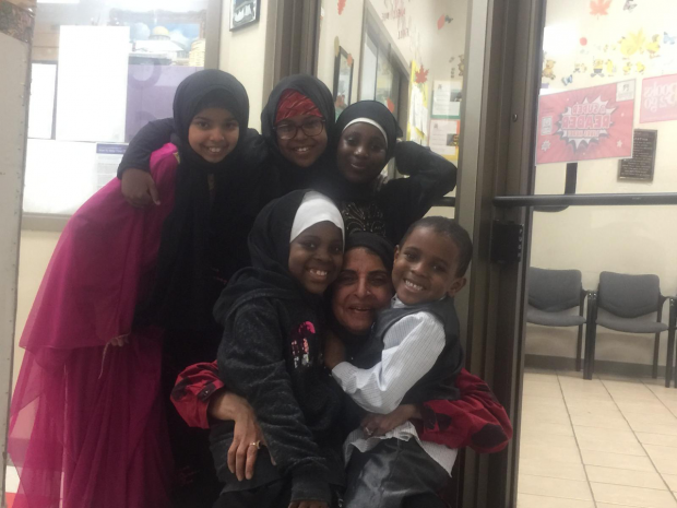 Rafat Arain with children she cares for at Crescent Learning Center in Milwaukee. Photo courtesy of Arain/WPR.