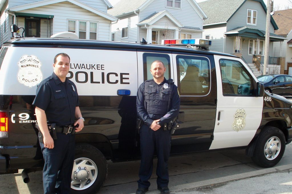 Under a state-mandated contract, MPD officers comb the streets for truants and shuttle them to a center where an MPS social worker evaluates their needs. MPD officers Shane Pecoraro and Ray Monfre are shown on the job in 2014. File photo by Kelly Meyerhofer/NNS.