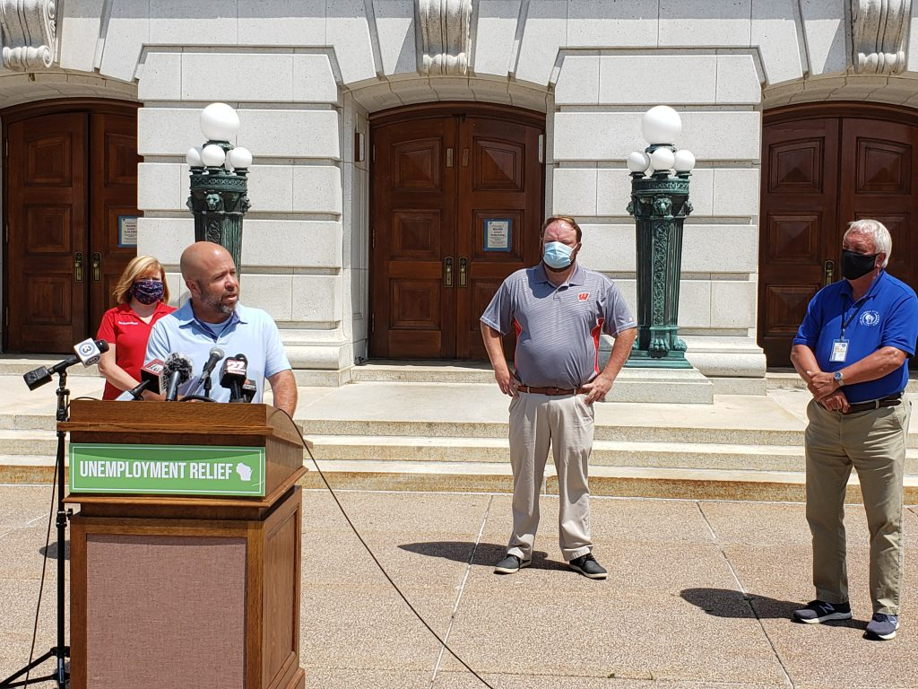 Assembly Majority Leader Jim Steineke (R-Kaukauna) speaks to reporters at a press conference in front of the state Capitol on Wednesday, Behind him from left are Rep. Barb Dittrich (R-Oconomowoc), Speaker Pro Tempore Tyler August (R-Lake Geneva) and Rep. Jon Plumer (R-Lodi). Photo by Erik Gunn/Wisconsin Examiner.