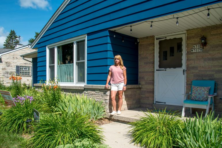 Rykki Casey is seen in front of her home in Cedarburg, Wis., on July 20, 2020. Casey, a health care worker and mother of four, had her absentee ballot rejected in Wisconsin's April presidential primary election. She says she is disappointed that her ballot, which was missing a witness address, did not count. Will Cioci / Wisconsin Watch.
