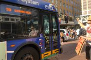 A Milwaukee County Transit System (MCTS) bus makes it way past a protest march on June 6th. Photo by Jeramey Jannene.