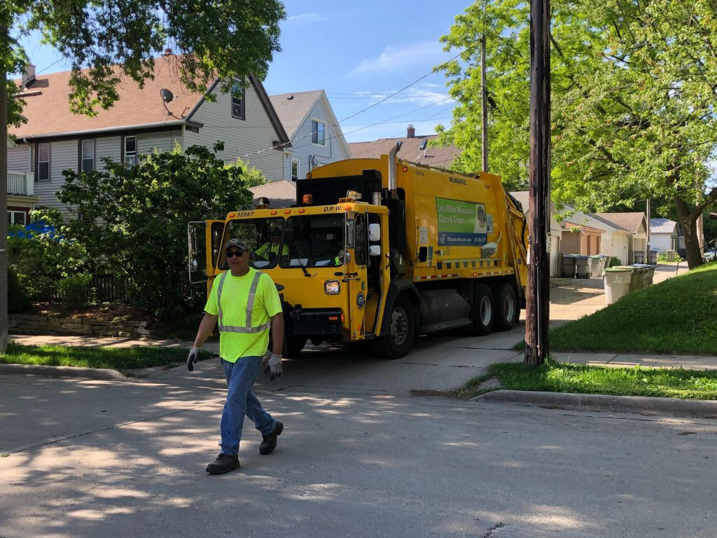 Department of Public Works sanitation workers in June 2020. Each year the city's Compete Milwaukee program places 50 people in temporary city jobs as part of the city's transitional jobs program. Photo by Jeramey Jannene.