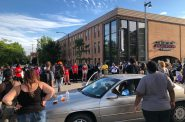 Marchers gather at 23rd and Wisconsin in honor of Ernest Lacy. Photo by Jeramey Jannene.