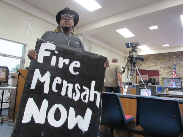 Protesters gather at Wauwatosa's City Hall. They called for the firing of Officer Joseph Mensah, but also for the implementation of body cameras at the police department. Photo by Isiah Holmes/Wisconsin Examiner.