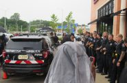 Wauwatosa officers form a line in front of Mayfair Mall's Cheesecake Factory. A few protesters had just been arrested. Photo by Isiah Holmes/Wisconsin Examiner.