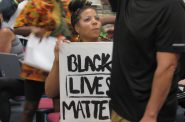A Black Lives Matter protester attending a Wauwatosa City Council meeting. Protesters had been marching to get officer Joseph Mensah fired for killing three people in five years. Photo by Isiah Holmes/Wisconsin Examiner.