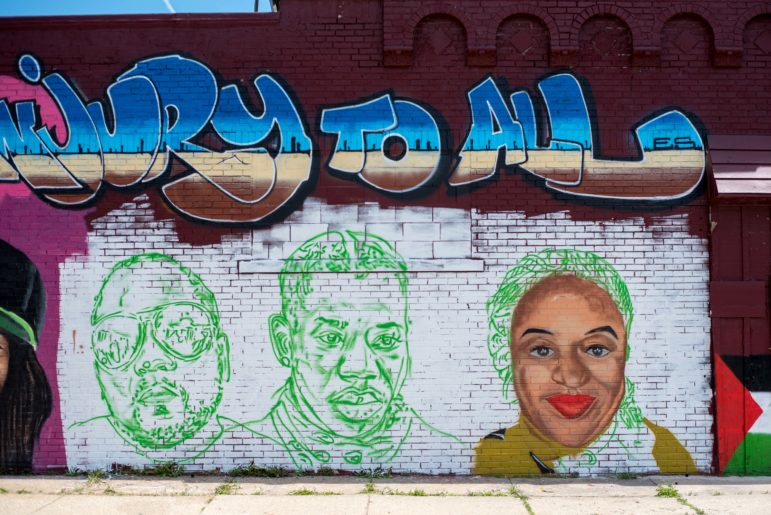 A mural painted near the corner of North 14th Street and West Vliet Street in Milwaukee depicts Monique Liston (right), a local activist and chief strategist at Ubuntu Research and Evaluation, a Black women-led consulting firm for education, policy and advocacy, on July 2, 2020. Liston underscores that societies haven't always relied on police, and that many of America's police systems were created to control Black people and protect the interests of the wealthy. Will Cioci / Wisconsin Watch.