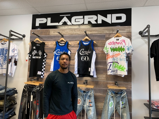 Synika Kirk opened PLAGRND in December, after he realized Green Bay didn't have many clothing stores for men. He's gotten a positive response from the community, he said. The store carries brands that are popular with young shoppers like Cookies and Supreme. Photo by Megan Hart/WPR.
