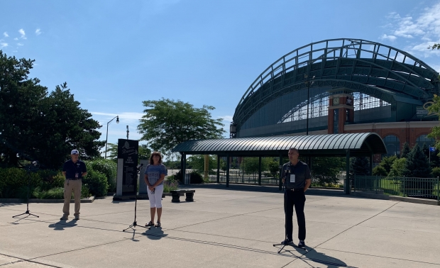 Guest services supervisor Jerry Mittelsteadt, cashier Marcie Kern and vice president of stadium operations Steve Ethier speak to reporters outside Miller Park on July 21, 2020. Megan Hart/WPR
