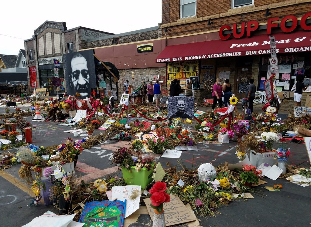 Bouquets of flowers, hand-written signs, paintings and other messages fill the intersection of Chicago Ave. and E. 38th St. in Minneapolis, where George Floyd was killed by police officers on May 25, 2020. This photo shows the memorials at the location, as seen on June 20, 2020. Kristian Knutsen/WisContext.