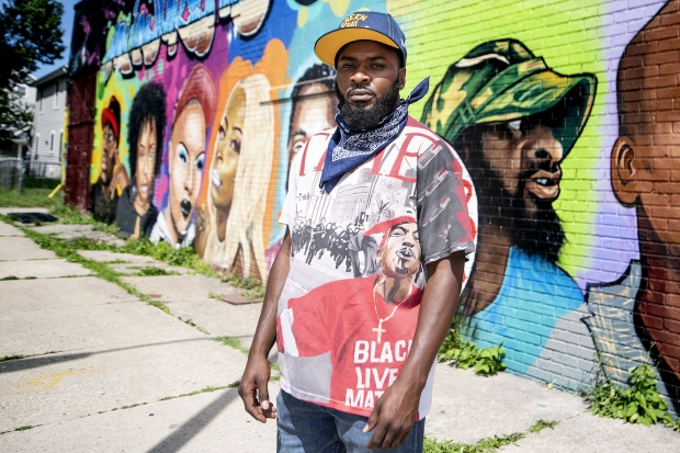 Khalil Coleman stands in front of a mural Thursday, Jul 30, 2020, in Milwaukee. Angela Major/WPR
