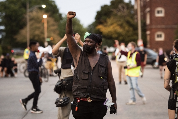 A protester who goes by Spaidez raises his fist as the protesters block off an intersection during their march Wednesday, Aug. 26, 2020, in Kenosha. Angela Major/WPR