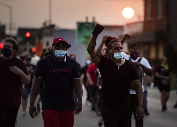 Protesters march in Kenosha on Tuesday night, Aug. 25, 2020. Angela Major/WPR