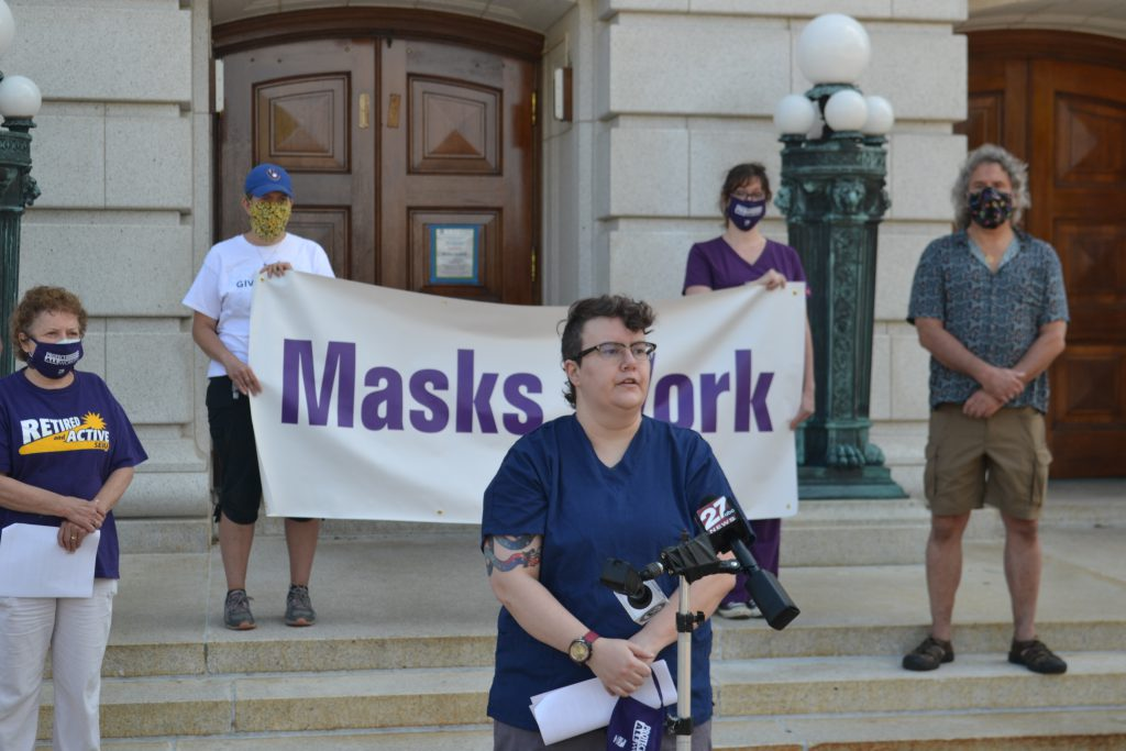 Madison nurse Kate Walton, seen here at an Aug. 6 news conference in support of Gov. Tony Evers' mask order, took part in a pre-Labor Day round table discussion on workers' lives in the COVID-19 pandemic. File photo by Erik Gunn/Wisconsin Examiner.
