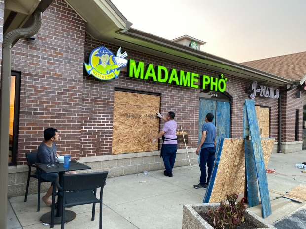 Sam Vong and his family boarded up Madame Pho in Kenosha on Wednesday night, Aug. 27, 2020.. Corrinne Hess/WPR