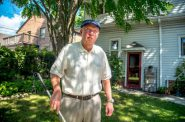 Don Natzke, 69, is seen in the backyard of his Shorewood, Wis., home on July 31, 2020. Natzke, who is visually impaired, was unable to vote in Wisconsin's April election as fear of the COVID-19 pandemic kept him from his in-person polling place and he faced several hurdles casting an absentee ballot. Photo by Will Cioci / Wisconsin Watch.