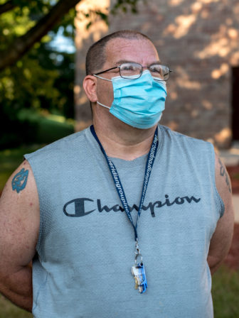 """Eugene Wilson is seen outside his Madison, Wis., apartment on Aug. 12, 2020. After months of filing weekly claims without progress, the 51-year-old Madison resident says the state's recent announcement that disability recipients might qualify for federal Pandemic Unemployment Assistance offers """"some sort of hope."""" Photo by Will Cioci / Wisconsin Watch."""