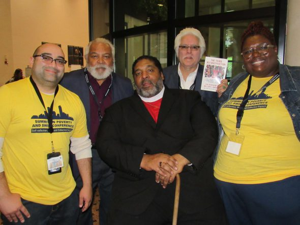 Rev. William Barber (center) and Poverty Summit Director Abra Fortson (right). Photo by Isiah Holmes/Wisconsin Examiner.