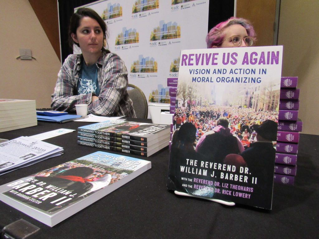 Books written by Rev. Barber and others were available at the Summit On Poverty Photo by: Isiah Holmes/Wisconsin Examiner.