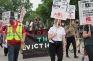 Protesters gather to march on Mayor Tom Barrett's house, to demand a freeze on evictions. Photo by Isiah Holmes/Wisconsin Examiner.