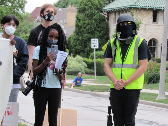 Christina Boyd stands alongside fellow rent protesters. Photo by Isiah Holmes/Wisconsin Examiner.